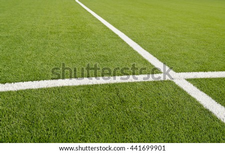 Lines on soccer field green grass. Abstract texture. - stock photo