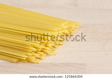 Linguine pasta on wooden board