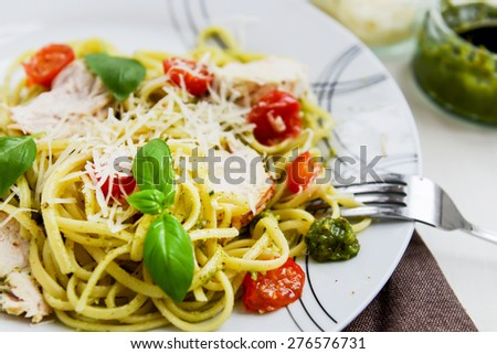 Linguine Pesto with Parmesan, Lemon Chicken, and baked baby plum tomatoes