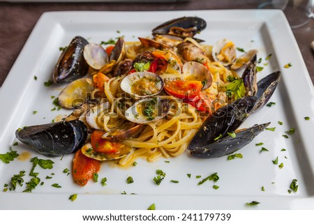 Linguini with baby clams and fresh mussels - stock photo