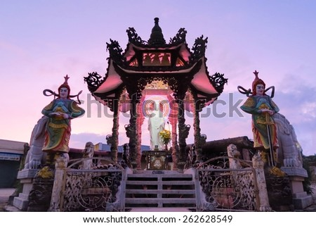 Linh Phuoc Buddhist pagoda is well-known for its big standing golden buddha . It is at the end of the tourist railway from Dalat main station. Da Lat City, Lam Dong province, Vietnam. - stock photo