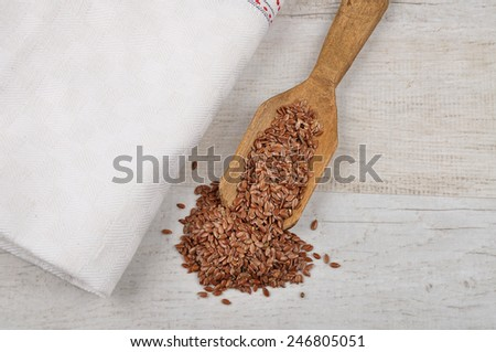 Linseed on shovel - stock photo