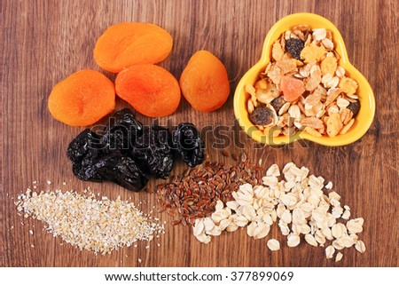 Linseed, rye flakes and oat bran, dried fruits and muesli, concept of healthy nutrition and increase metabolism, ingredients with dietary fiber - stock photo