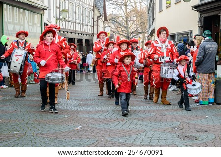 LINZ AM RHEIN, GERMANY 16 FEBRUARY 2015 - Unidentified persons attending a carnival procession to celebrate the end of Karneval season, an annual event held throughout certain regions in Germany