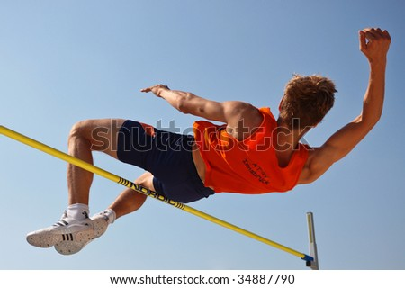 LINZ, AUSTRIA - AUGUST 2 Austrian track and field championship: Oliver Baumgartner places third in the men's high jump event on August 2, 2009 in Linz, Austria. - stock photo