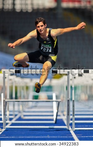 LINZ, AUSTRIA - AUGUST 2 : Philipp Huber (No. 237) finishes fifth in the men's 110m hurdles event at Austrian track and field championship August 2, 2009 in Linz, Austria. - stock photo