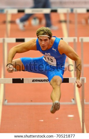 LINZ,  AUSTRIA - FEBRUARY 3 Linz indoor track and field meeting.  Manuel Prazak (#118, Austria) places seventh in the men's 60m hurdles event on February 3, 2011 in Linz, Austria.