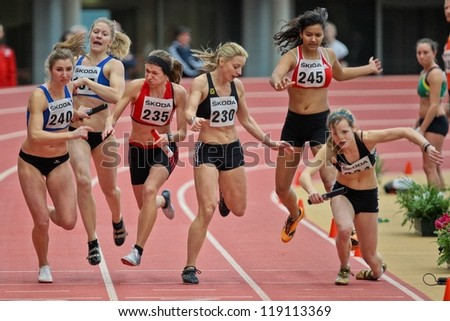LINZ, AUSTRIA - FEBRUARY 25: Michaela Egger (#230, Austria) and her team place third in the women's 4x200m relay event in Linz, Austria on February 25, 2012. - stock photo