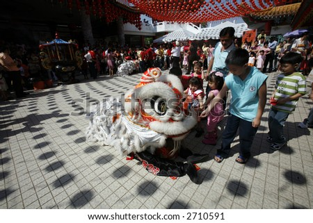 Lion dance at Chinese temple. - stock photo