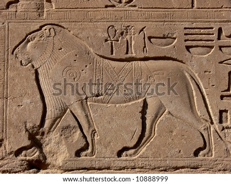 Lion - egyptian basrelief and hieroglyphs in Karnak temple, Luxor, Egypt - stock photo