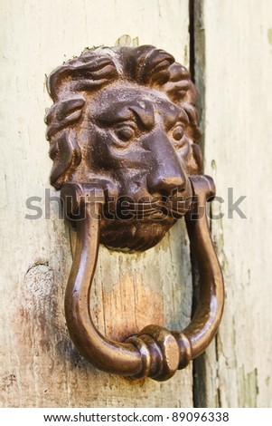 Lion face knocker on a door in Antigua Guatemala (Guatemala, Central America)