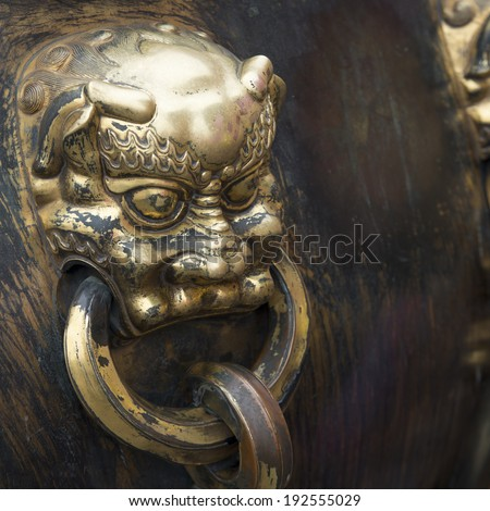 Lion handle on a bronze urn at the Forbidden City, Xicheng District, Beijing, China - stock photo