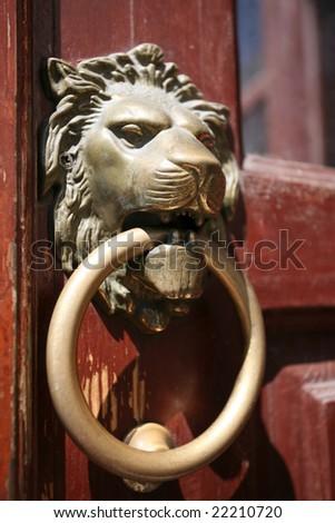 Lion head door knocker - stock photo
