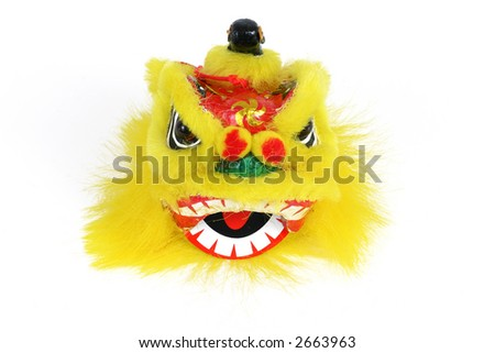 Lion head isolated over white. This head is used for the chinese lion dance. - stock photo