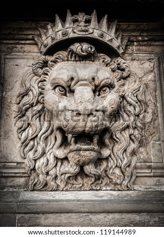 Lion head relief on the facade - stock photo