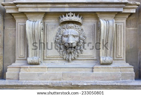 Lion head relief on the facade of Pitti Palace, Florence, Italy - stock photo