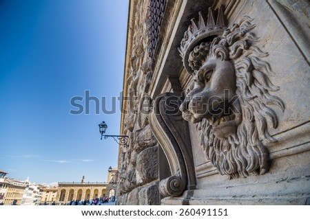 Lion head relief on the facade of Pitti Palace, Florence, Tuscany, Italy - stock photo