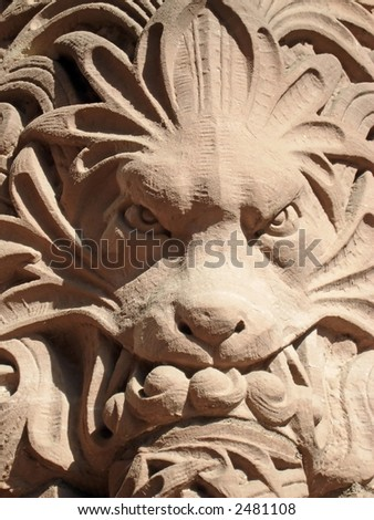 Lion on the side of the Parliament buildings, Queens Park, Toronto, Ontario, Canada. - stock photo