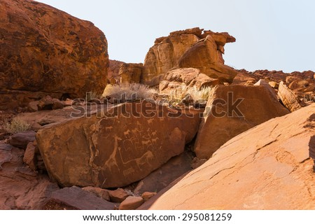 Lion Plate with Lion Man and other bushman prehistoric rock engravings at Twyfelfontein, Namibia - stock photo