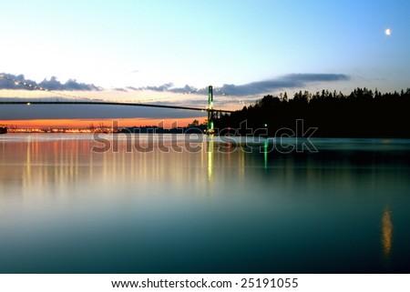 Lion's Gate bridge at sunrise. - stock photo