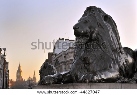 Lion sculpture at Nelson's Column Memorial, Trafalgar Square, London, England. With Big Ben in the background. - stock photo
