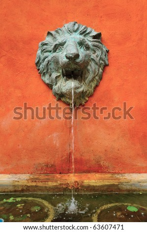 Lion Sculpture with spring water - stock photo