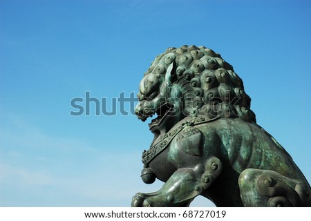Lion statue by the forbidden city building,Forbidden City in Beijing, China. - stock photo