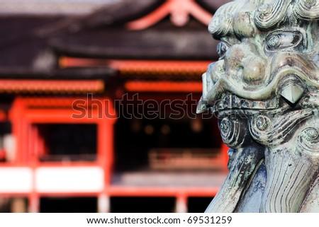 Lion statue guarding the entrance to the Miyajima Shrine, Miyajima Island, near Hiroshima, Japan. - stock photo