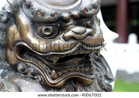 Lion statue in a temple - stock photo