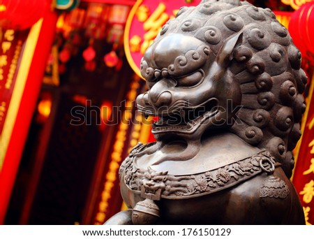 Lion statue in Chinese temple - stock photo