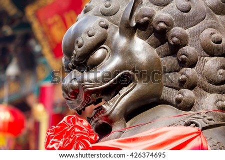 Lion statue in front of chinese temple