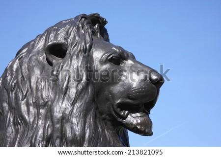 Lion statue in Trafalgar Square - stock photo