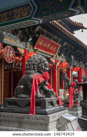 Lion statue in Wong Tai Sin Temple in Hong Kong  - stock photo