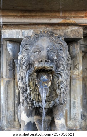 Lion statue with streaming water from mouth near Cologne cathedral, Germany  - stock photo