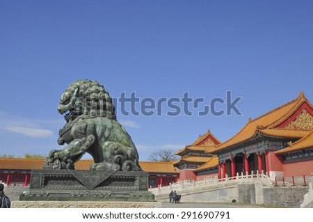 Lion stature at the Forbidden City (Palace Museum) in China - stock photo