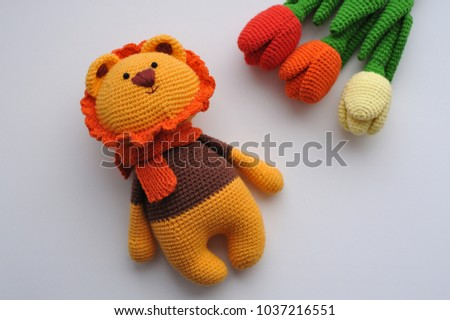 Lion toy knitted in the technique of knitting amigurumi.
