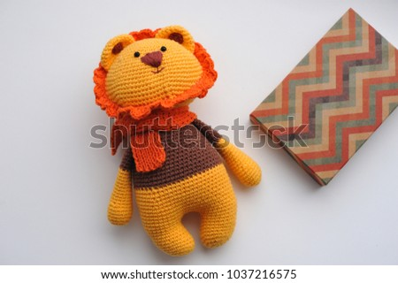 Lion toy knitted in the technique of knitting amigurumi
