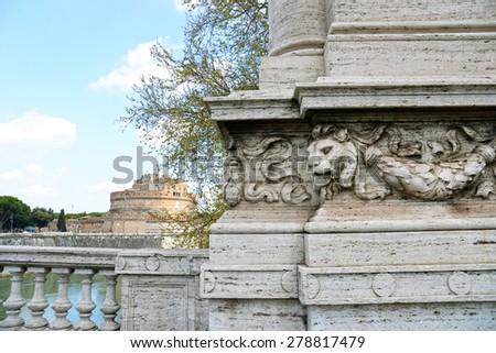 Lion with view of famous Saint Angel castle and bridge over the Tiber river in Rome, Italy. - stock photo