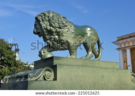 Lions at the Admiralty embankment, two lion sculptures in bronze, copies of the late 16th century Italian Medici lions in Florence, Saint Petersburg, Russia - stock photo