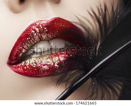Lips and feather - stock photo
