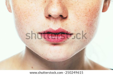 Lips and nose Woman freckle happy young beautiful studio portrait with healthy skin - stock photo