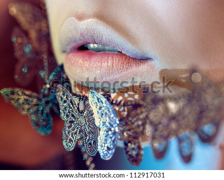 lips close-up women face butterfly illuminated - stock photo