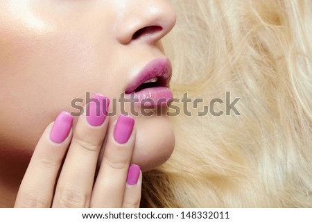 lips,nails and hair of beautiful blond woman. face without eyes - stock photo