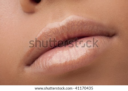 Lips of the young girl - stock photo