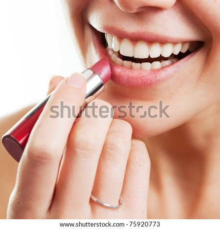 Lipstick and happy female lips over white - stock photo