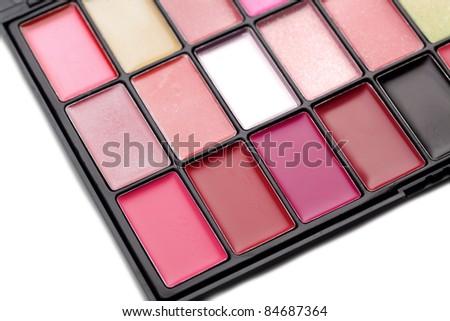 Lipstick and lipgloss makeup palette - stock photo