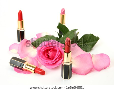 Lipstick and petals of roses  - stock photo
