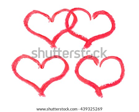 Lipstick drawing hearts isolated on white background - stock photo