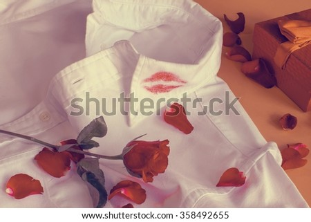 Lipstick kiss on shirt collar in Valentines Day(Vintage) - stock photo
