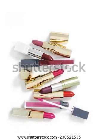 lipstick on white with shadows - stock photo